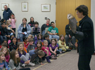 Jeanne and Silo, the barn owl, at the Wallingford Library.