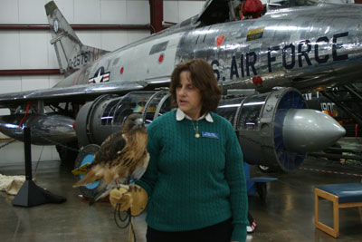Mary Beth and Dakota, the red-tailed hawk, at Open Cockpit Day at the New England Air Museum.