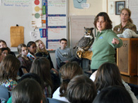Mary-Beth and Emrys, the barred owl, in the 4th grade at Wapping School.