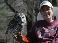 Volunteer Sandy with Emrys the barred owl.